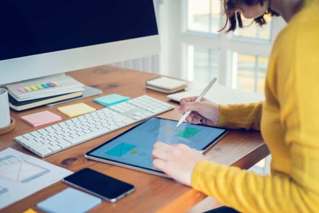houston web designer at desk